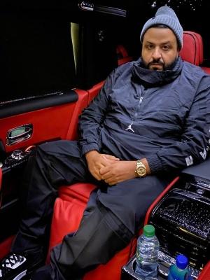 Dj Khaled Wearing A Air Jordan Black Anorak Jacket With Black Trackpants And Jordan 3 Sneakers
