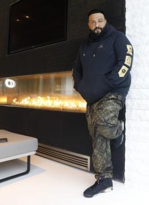 Dj Khaled Wearing A Black Jordan Hoodie With Lv X Supreme Camo Pants And Jordan 6 Dmp Sneakers