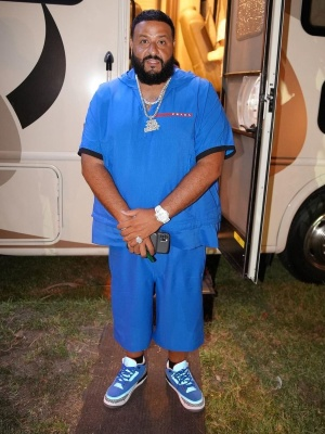 Dj Khaled Wearing A Blue Prada And Jordan Outfit