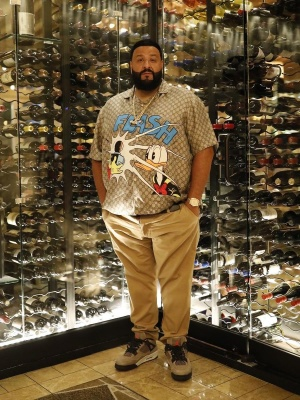 Dj Khaled Wearing A Gucci X Disney Shirt With A Rolex Watch And Jordan Sneakers