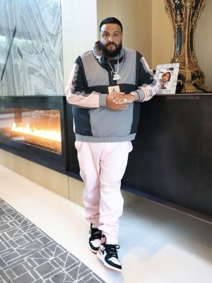 Dj Khaled Wearing A Jordan Anorak Windbreaer Jacket And Matching Jordan 1 High Sneakers