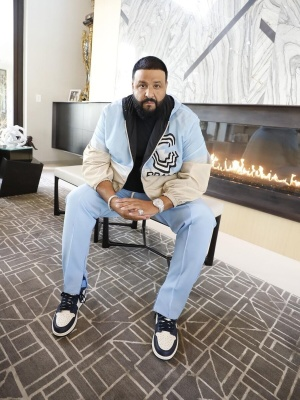 Dj Khaled Wearing A Prada Windbreaker Jacket With Jordan Obsidian Unc Sneakers
