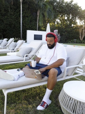 Dj Khaled Wearing Jordan Swim Shorts With Nike X Nocta Socks And Gucci Pool Slides