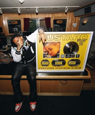 Dj Mustard Shows Off His Platnium Plaque In A Louis Vuitton Varsity Jacket And White Orange Trainer Sneakers