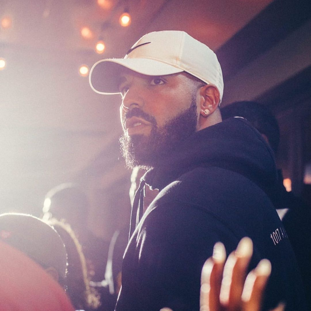 Drake Wearing A Nike Hat And Black Alyx Hoodie
