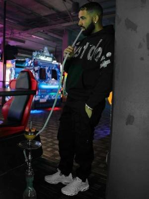 Drake Wearing A Nike X Cactus Plant Flea Market Hoodie With Nike Air Max Sneakers