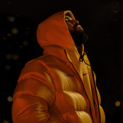 Drake Wearing A Nocta Yellow Hoodie And Nocta Yellow Puffer Jacket