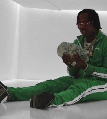 Est Gee Wearing A Palm Angels Green Track Jacket And Green Trackpants With Dolce Gabbana Black Sorrento Sneakers
