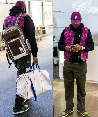 Fabolous Wearing A Bape Purple Hat And Vest With An Bape X Alpha Industries Hoodie Louis Vuitton Backpack And Duffle Bag And Bapesta Sneakers