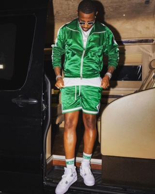 Fabolous Wearing An Amiri Green Satin Track Jacket And Shorts With Rhude Socks And Jordan Sneakers