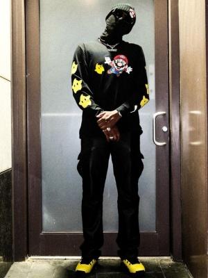 Fabolous Wearing Louis Vuitton Sunglasses With A Puma X Nintendo Long Sleeve T Shirt And Jorda 17s