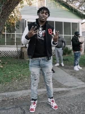 Fredo Band Wearing A Black White B Logo Varsity Jacket With Amiri Jeans And Jordan Sneakers