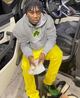 Fredo Bang Wearing A Yellow And Green Off White Jordan And Palm Angels Fit