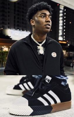 Freedo Band Wearing A Gucci Jacket And Adidas X Alexander Wang Sneakers