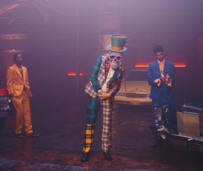 French Montana Slide Music Video Wearing A Plaid Suit And Black And Red Shoes
