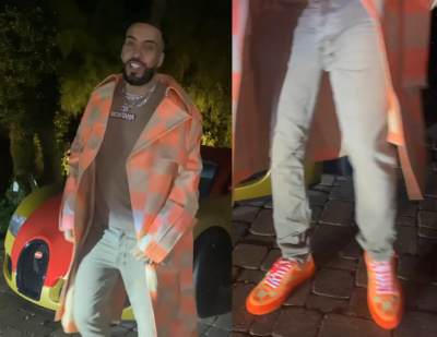 French Montana Wearing A Louis Vuitton Beige Damier Trench Coat And Orange Sneakers