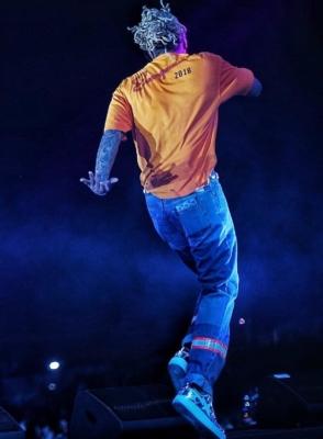 Future Wearing An Orange Balenciaga Shirt Calvin Klein Jeans And Bape Metallic Sneakers