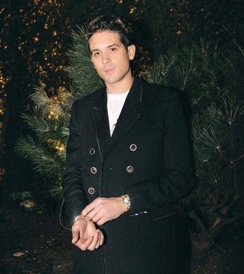 G Eazy Instagram Post Wearing A Black Double Breast Peacoat And A White Lacoste T Shirt