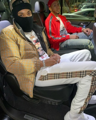 G Herbo Wearing A Burberry Check Hat And Puffer Jacket With White And Check Stripe Pants