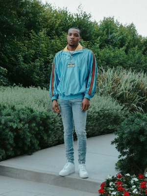 G Herbo Wearing A Gucci Light Blue Pullover Jacket With Amiri Shotgun Jeans And Nike Air Force 1 Sneakers