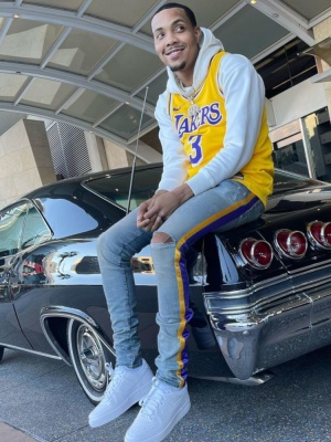 G Herbo Wearing A La Lakers Yellow Jersey With Amiri X Lakers Jeans And Nike Air Force 1s