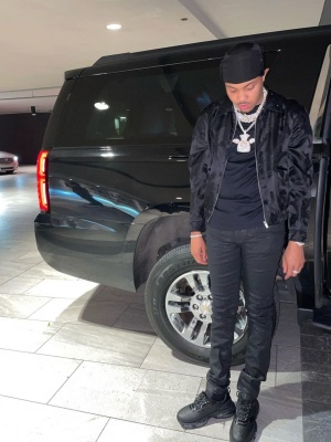 G Herbo Wearing A Saint Laurnet Black Palm Tree Jacket With Black Jeans And Prada Sneakers