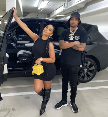 G Herbo With Taina W In A Dior X Shawn Black Polo Shirt And Dior Cd1 Black Sandals