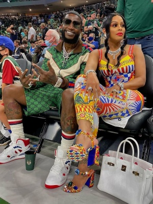 Gucci Mane Wearing A Green Gucci Tracksuit With White Socks And White High Top Basket Sneakers