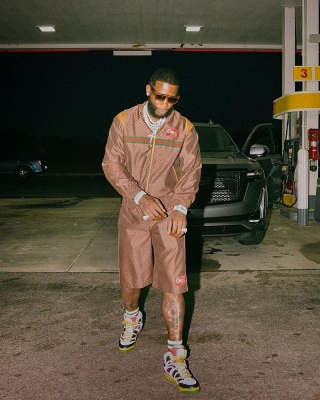 Gucci Mane Wearing A Gucci Brown Mini Gg Bomber Jacket And Shorts With Gucci Basket High Top Sneakers