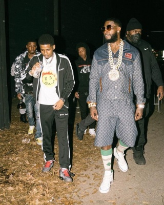 Gucci Mane Wearing A Gucci Denim Jacket And Shorts With Whtie Tennis Sneakers And Striped Socks