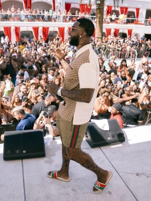 Gucci Mane Wearing A Gucci Split Polo And Gg Shorts With Web Stripe Slides