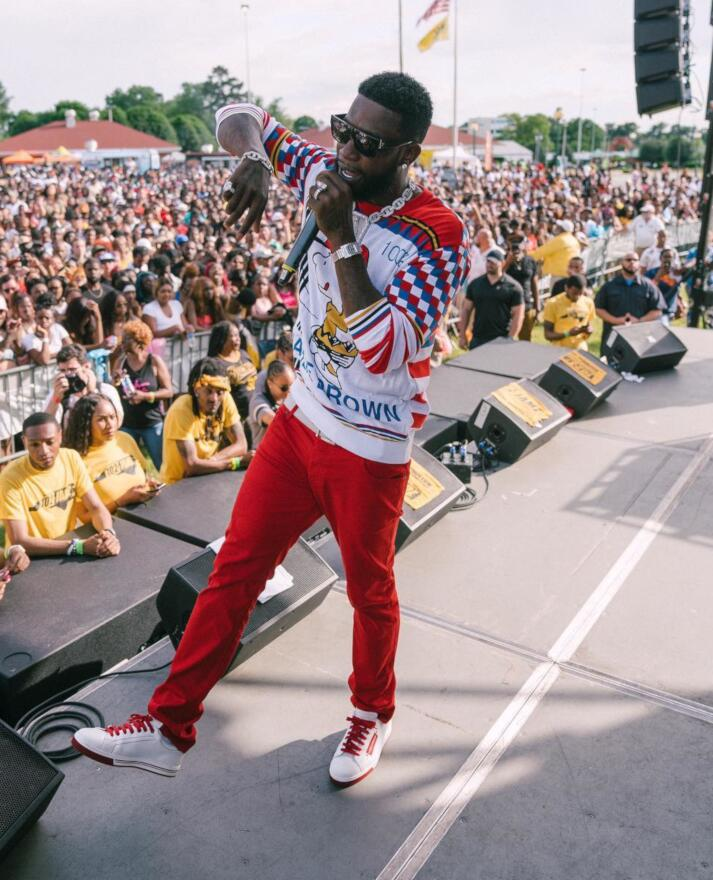 Gucci Mane Wearing A White Charlie Brown Sweater On Stage