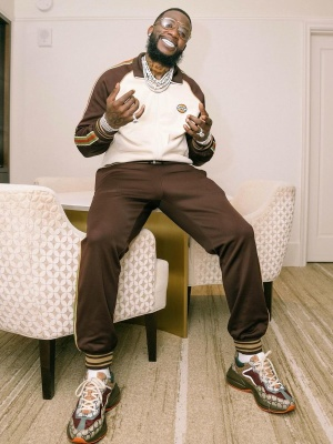 Gucci Mane Wearing An Gucci Brown And White Track Jacket With Brown Joggers And Brown Rhyton Sneakers