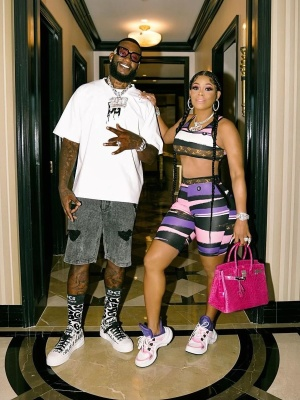 Gucci Mane Wearing Gucci Sunglasses With A Dolce Gabbana Tee Short Socks And Sneakers