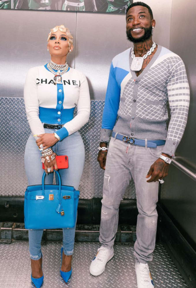 Gucci Mane With His Wife Wearing A Grey Cardigan With Grey Dsquared2 Jeans White Sneakers And A Light Blue Ferragamo Belt
