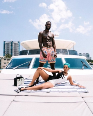 Gucci Mane With His Wife Wearing Red And White Striped Swim Shorts
