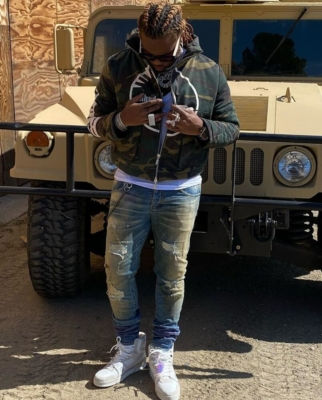 Gunna Next To Military Hummer In Rhude Camo Jacket Louis Vuitton Sneakers