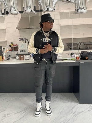 Gunna Wearing A Celine Bucket Hat Varsity Jacket And Te Shirt With Rick Owens Cargo Pants And Celine High Top Sneakers