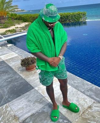 Gunna Wearing A Green Kapital Bucket Hat With Amiri Green Shorts And Green Bottega Veneta Slides
