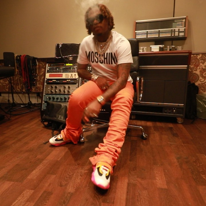 Gunna Wearing A Moshino Logo Print T Shirt Orange Pants And Moschino Colorblock Sneakers