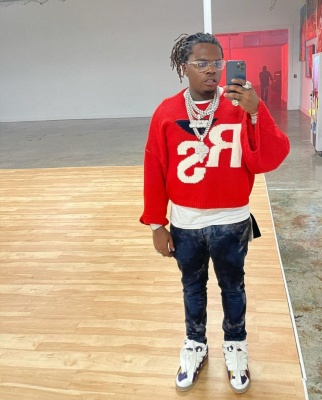 Gunna Wearing A Raf Simons Sweater Chrome Hearts Glasses And Lanvin Sneakers
