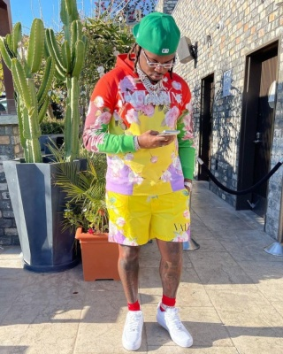 Gunna Wearing A Valentino Multicolor Floral Hoodie And Yellow Floral Swim Shorts With Nike Air Force 1s