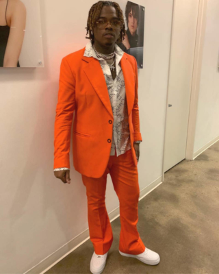 Gunna Wearing An Orange Acne Studios Blazer And Orang Acne Studios Pants With A White Valentino Vltn Print Shirt