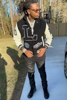 Gunna Wearing Louis Vuitton Sunglasses And Varsity Jacket With Black Jeans Jordan 1s And An Audemars Piguet Watch