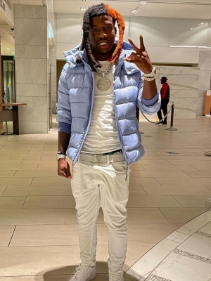 Hotnboii Wearing A Light Blue Moncler Puffer Jacket With A White Louis Vuitton Belt White Jeans And Nike Air Force 1s