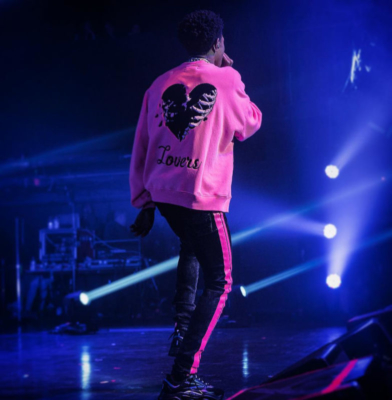 Instagram Picture Of A Boogie Wit Da Hoodie Wearing A Pink Amiri Lovers Crewneck Black Amiri Jeans With A Pink Side Stripe And Dior B22 Sneakers In Black And Pink