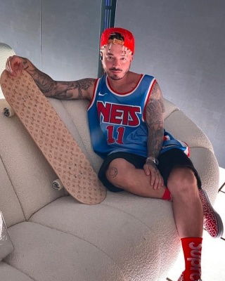 J Balvin Wearing A Brooklyn Nets Jersey With Supreme X Nike Socks And Supreme X Vans Sneakers
