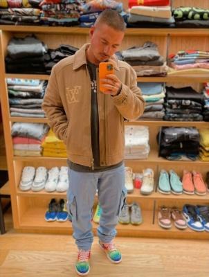 J Balvin Wearing A Louis Vuitton X Nigo Brown Jacket With Jordan Collab 1s