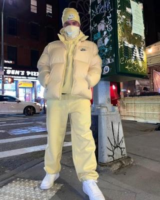 J Balvin Wearing A Nike X Supreme Yellow Puffer Jacket Hoodie Sweatpants And Beanie