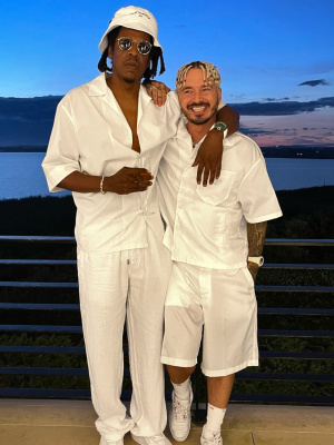 J Balvin Wearing A Prada White Re Nylon Shirt And Shorts With Supreme X Hanes Socks And An Audemars Watch